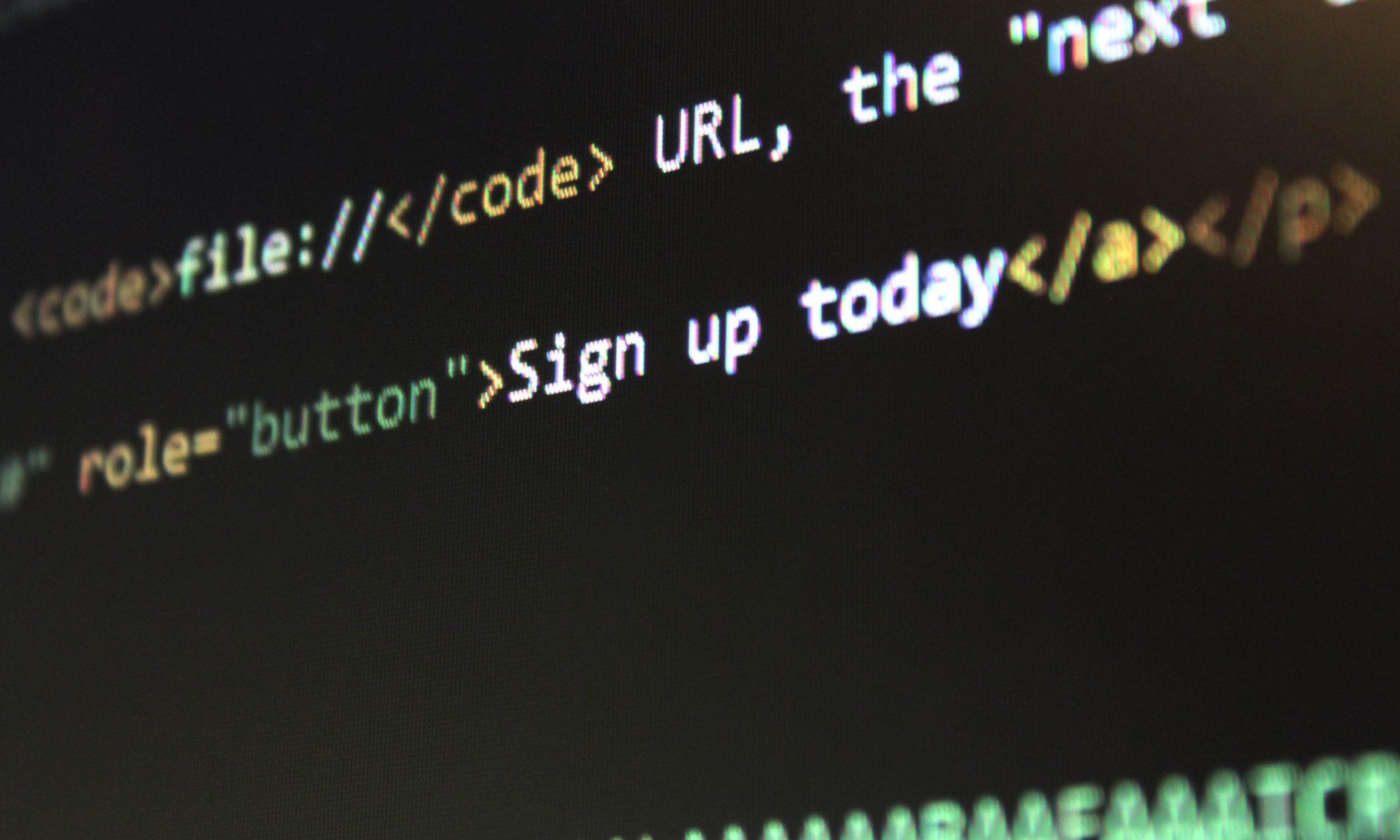 image of PC screen showing HTML code used in website design - Suffolk copywriting - Suffolk copywriter