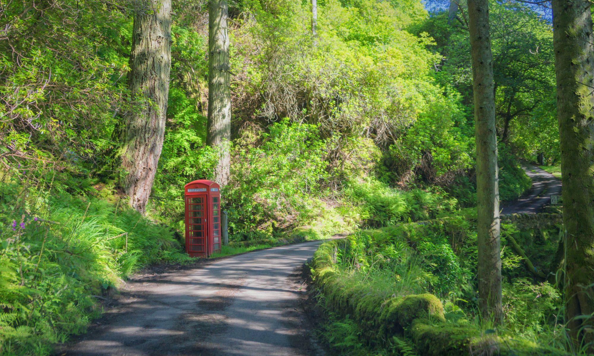 Red UK phone box on leafy country lane - suffolk copywriter - Suffolk copywriting